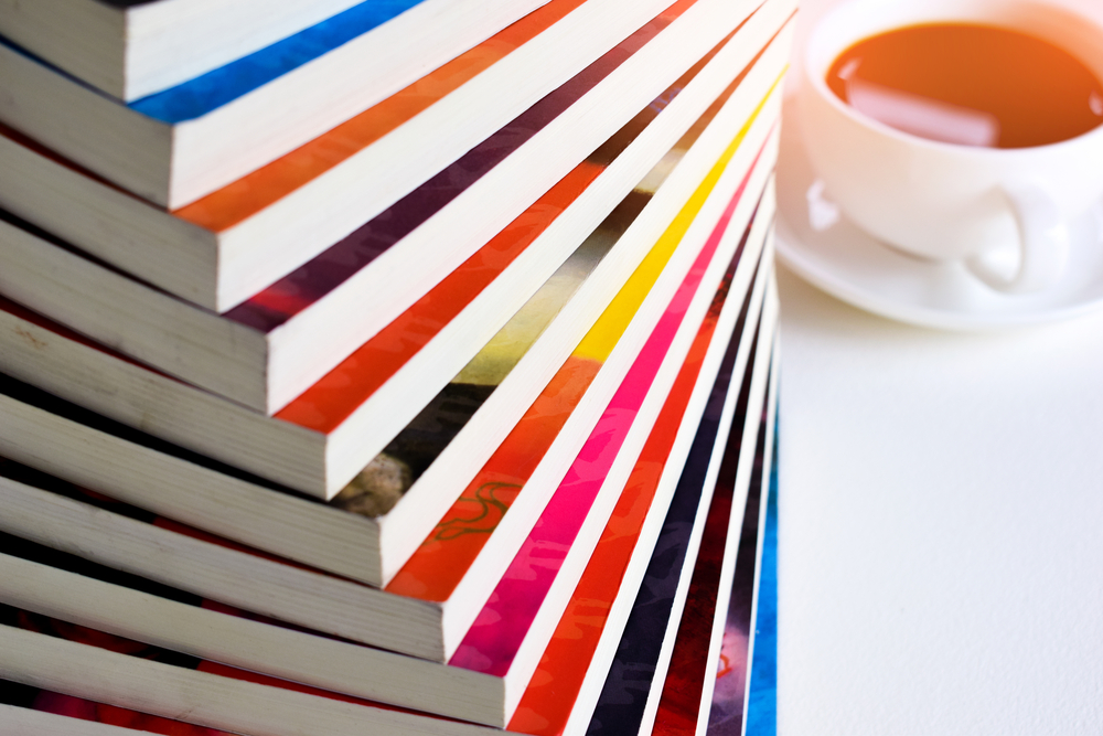 A stack of graphic novels on a white background