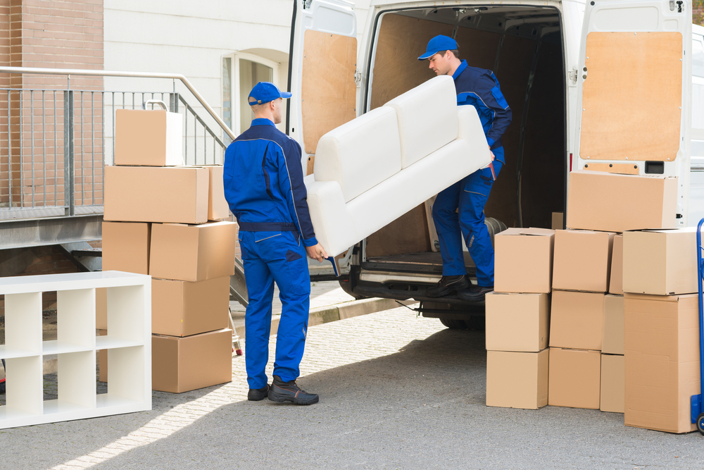 professional movers moving items to a self-storage unit