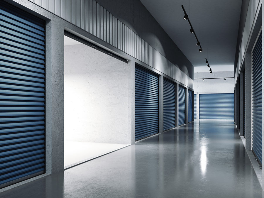 Open storage unit in a facility with blue doors