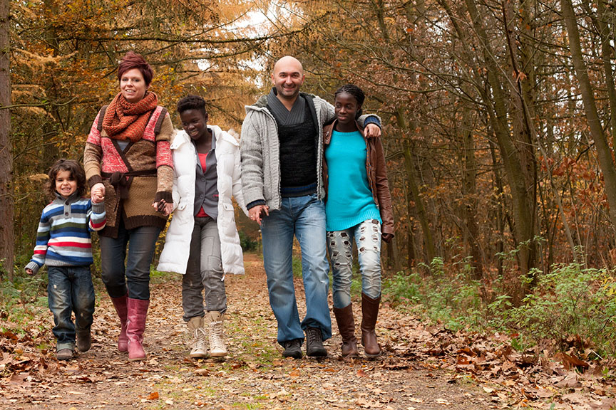 foster family walking through woods