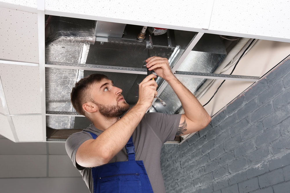 Man conducting maintenance