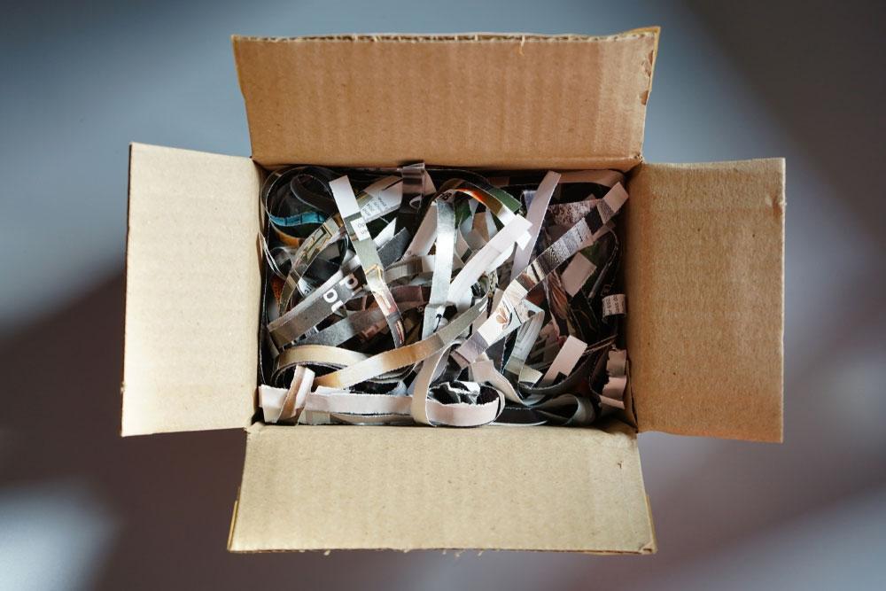 Box full of newspaper scraps