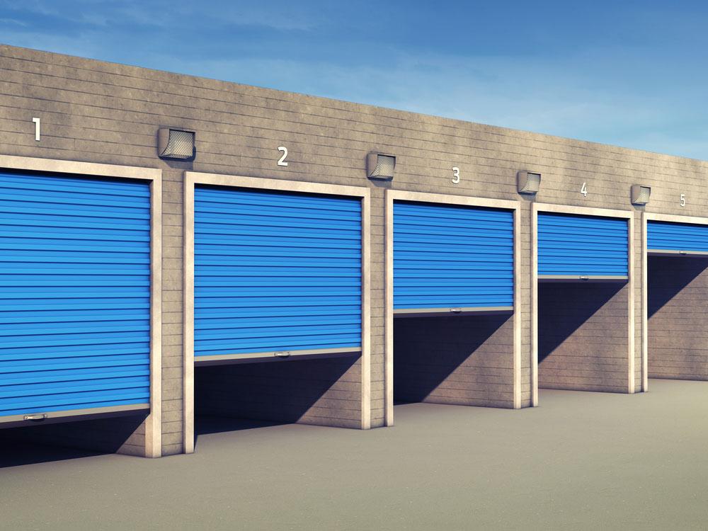 Outdoor storage units with open doors.