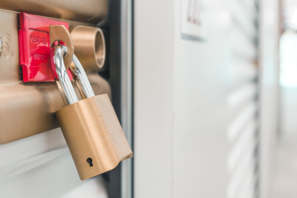 Close up picture of a padlock on a storage unit door