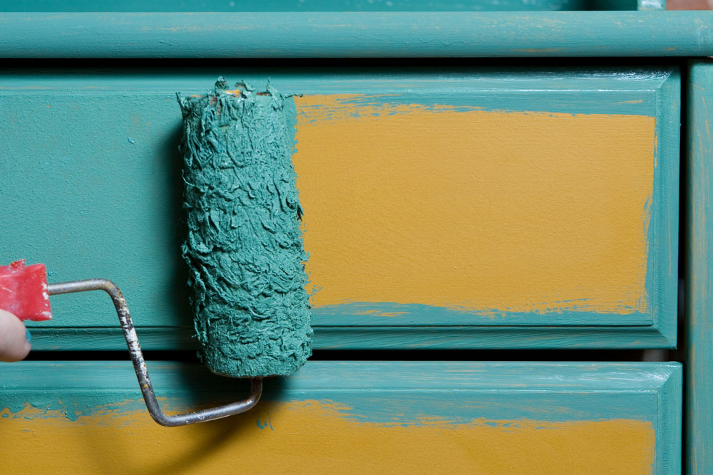 Someone painting furniture blue