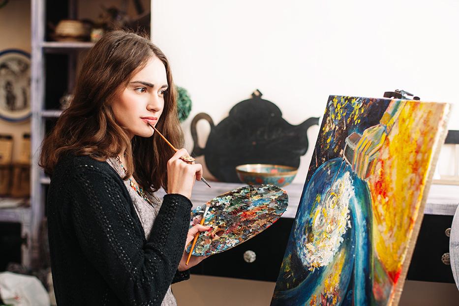 Pensive painter pondering painting