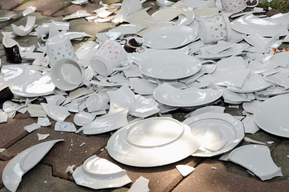 Dishes dropped and broken on way to storage facility