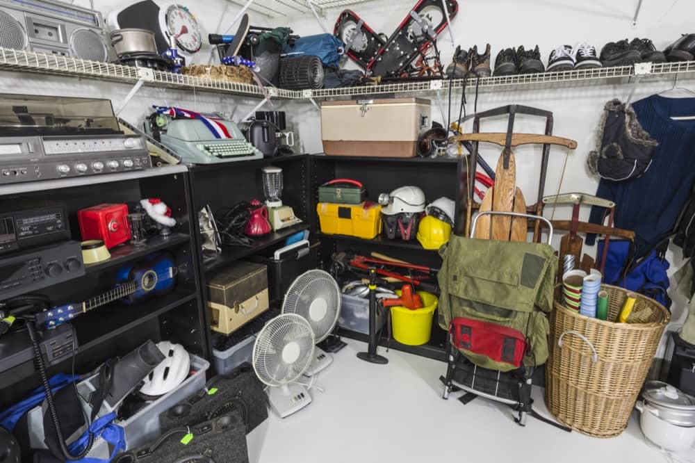cluttered garage needs storage solutions from Affordable Family Storage
