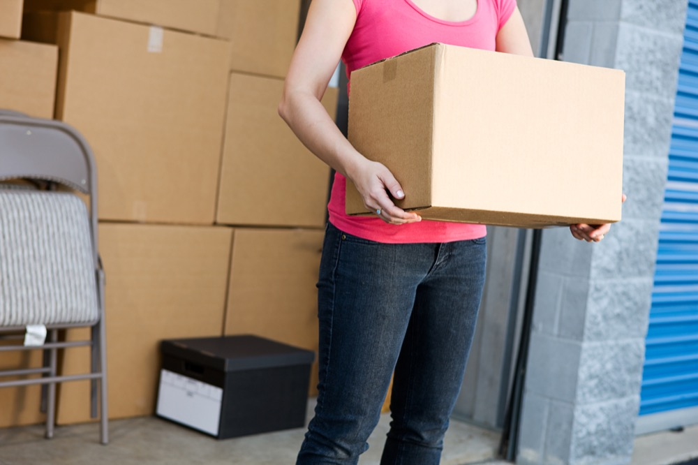 Woman moving boxes out of her storage unit