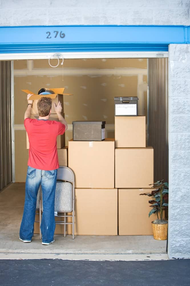 man finishes loading boxes of books into self-storage