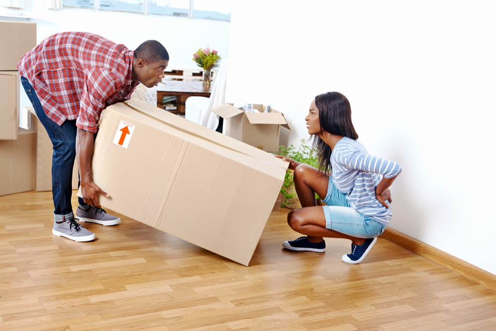 woman injures back lifting heavy box