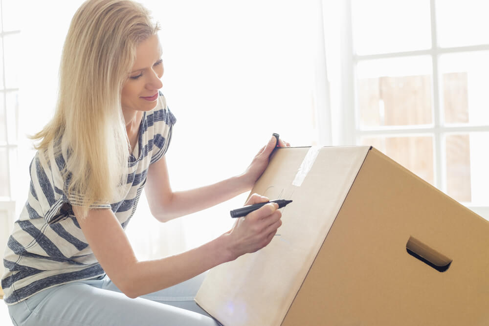 Woman sorting her boxes