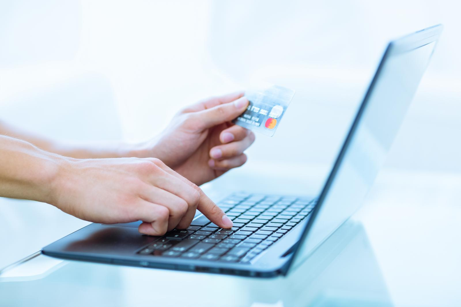 Woman using AutoPay at Affordable Family Storage