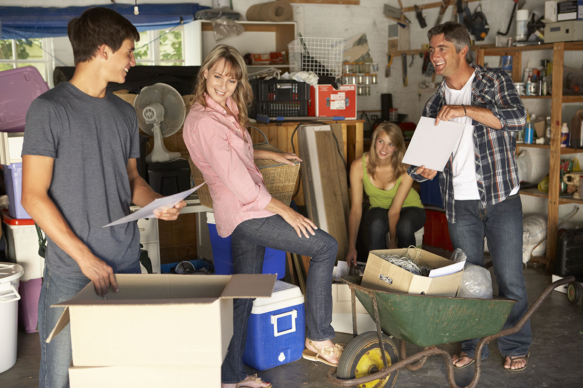 Family moving items from self storage unit to yard sale