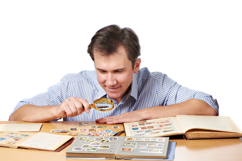 Man preparing stamp collection for storage space