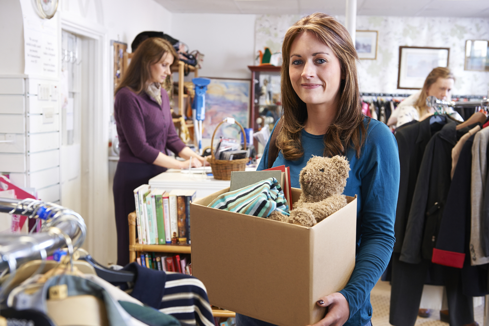 Woman donating items instead of placing in storage unit