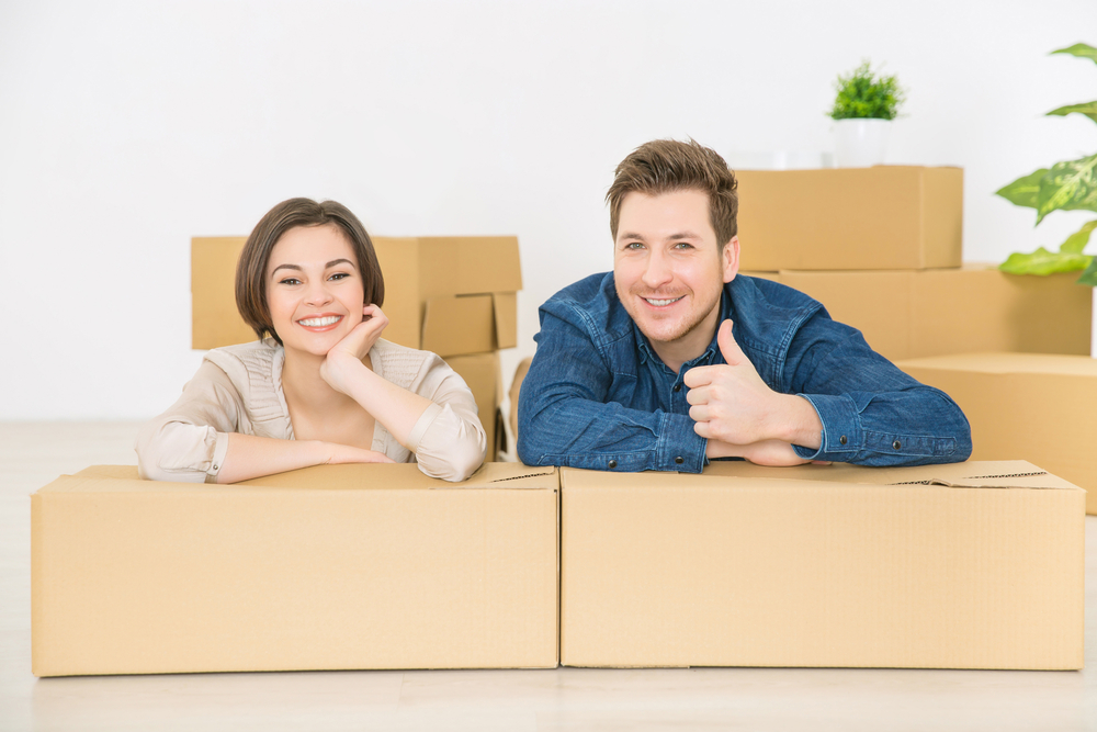 Newlyweds combining belongings before moving to storage unit