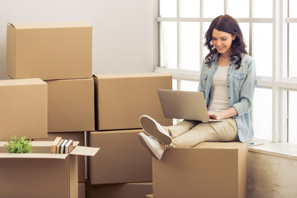 Young woman moving out of her dorm
