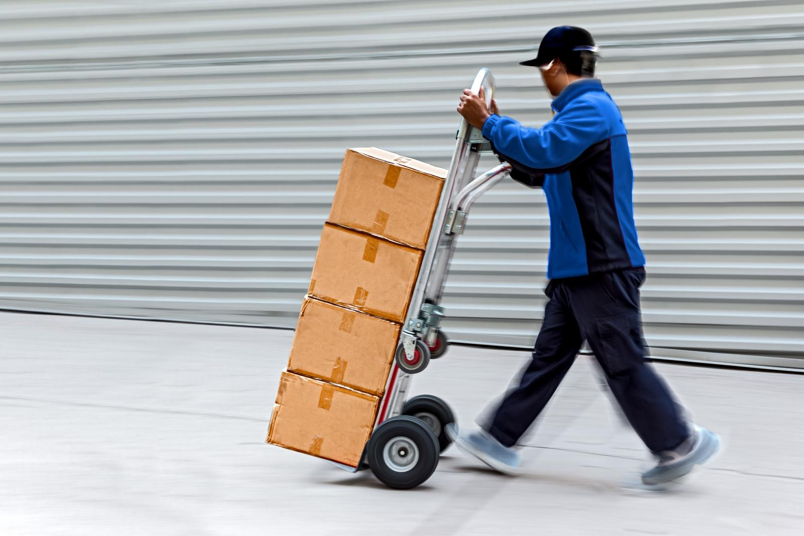 man uses handcart to make moving to Affordable Family Storage unit easier