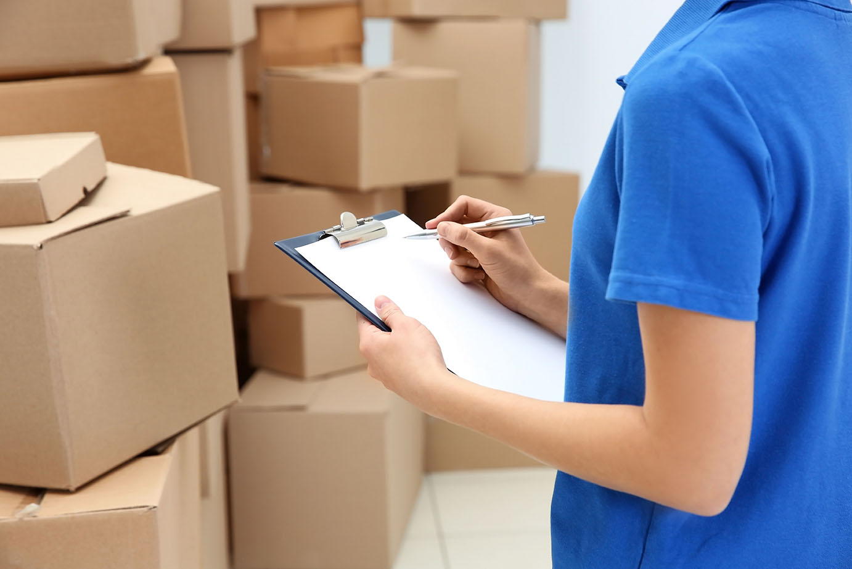 Woman checking storage insurance options