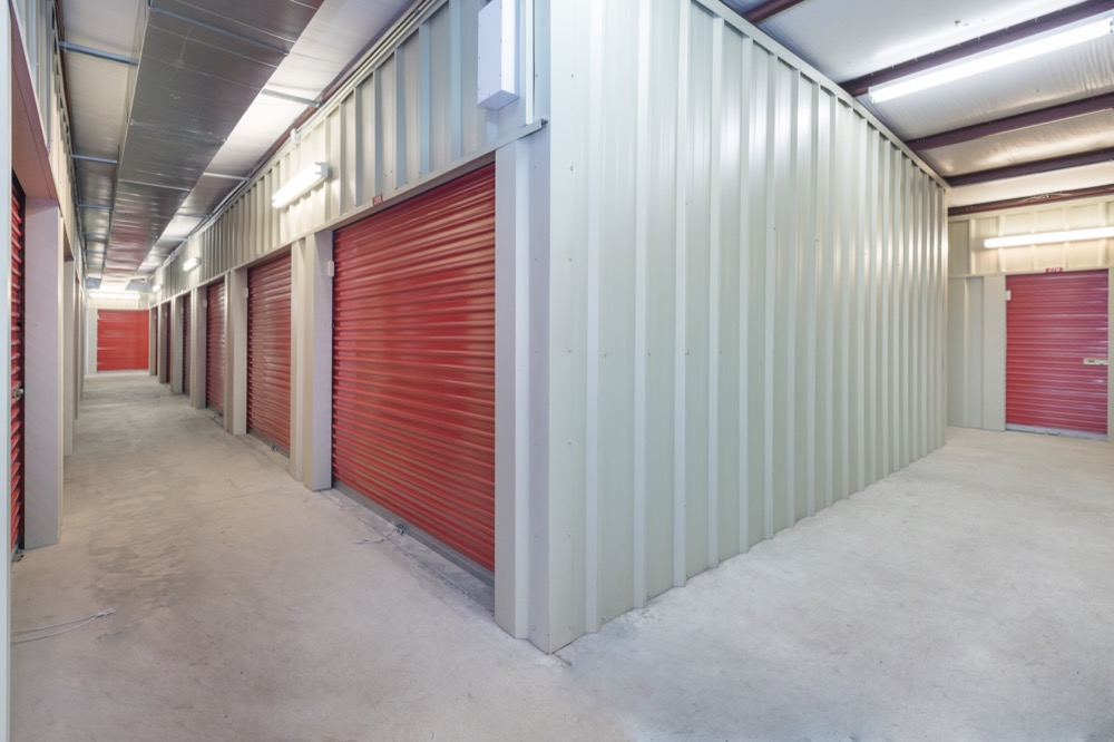 self-storage interior facility with red doors
