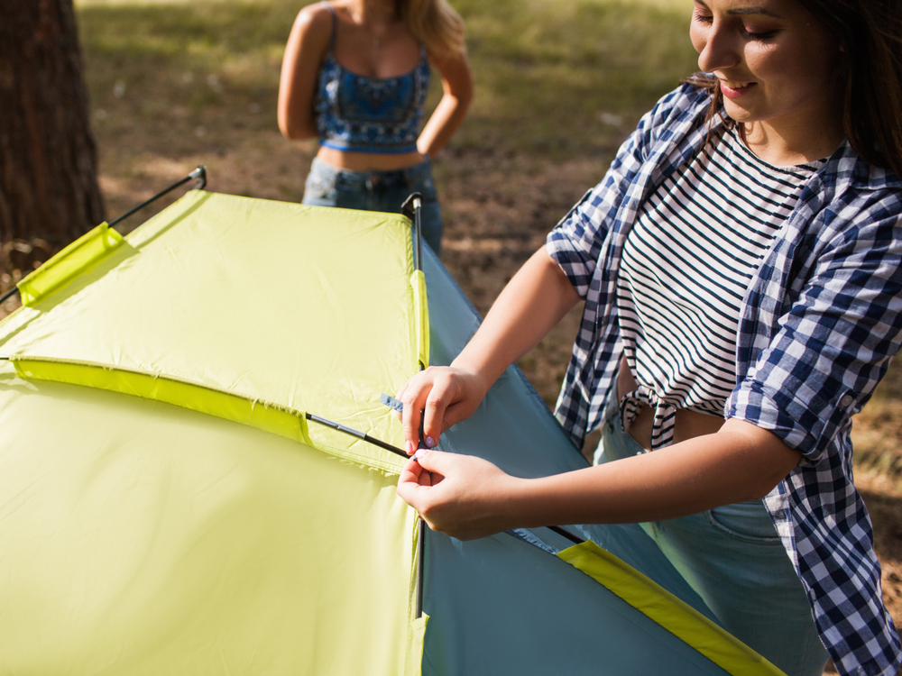 Woman breaking down tent to prepare for self storage