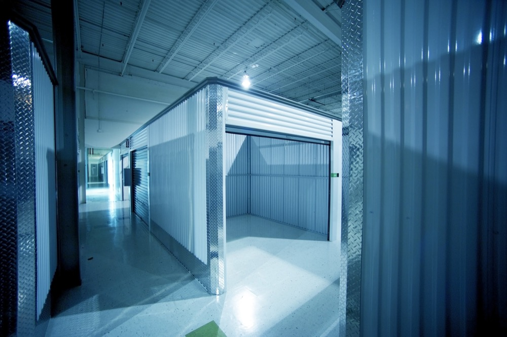 climate-controlled storage unit in blue-lit facility