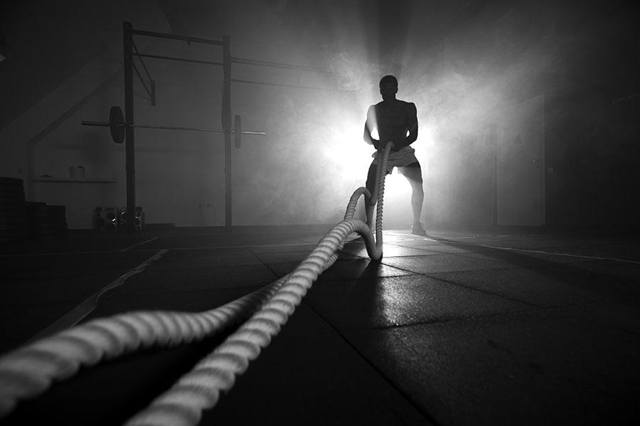 silhouette of man training in dark room