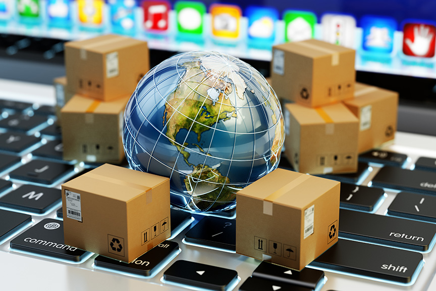 Tiny boxes and planet on keyboard representing e-commerce