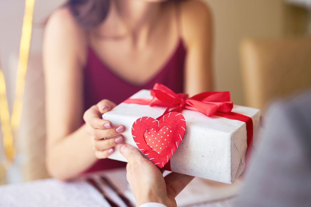 Couple sharing gifts on Valentine's Day