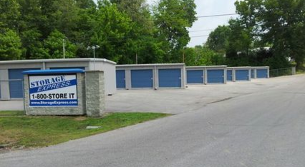 Storage Facility Units And Sign As Seen From The Driveway