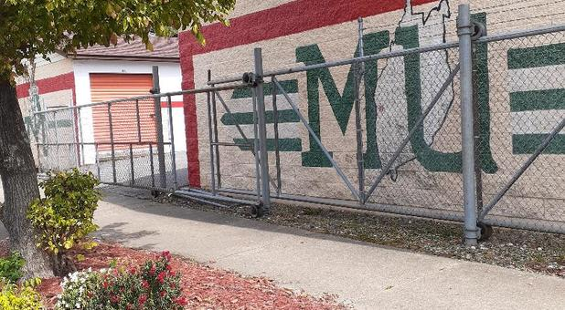 marshall university logo on gate storage building