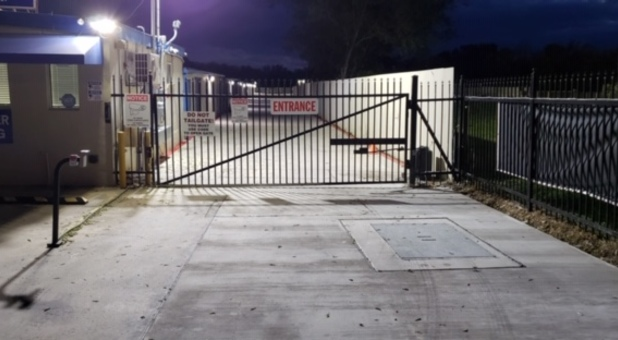 Front gate at night for Self Storage