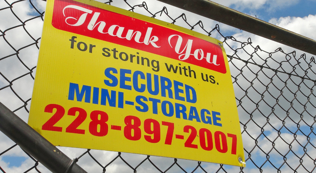 secured mini storage sign