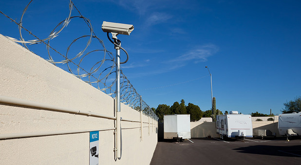 Security Camera And Barbed Wire At Sun City Storage Solutions