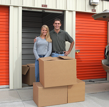Happy couple infront of their storage unit.
