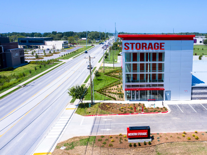 Aerial photo of the entrance to Modern Storage in Bentonville on SW 14th Street, across the street from Climb Bentonville and Bentonville Brewing Company.