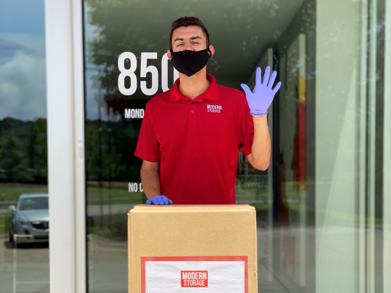 Photo of a Modern Storage staff member wearing a mask and gloves. We offer contactless rental options to help keep you safe!