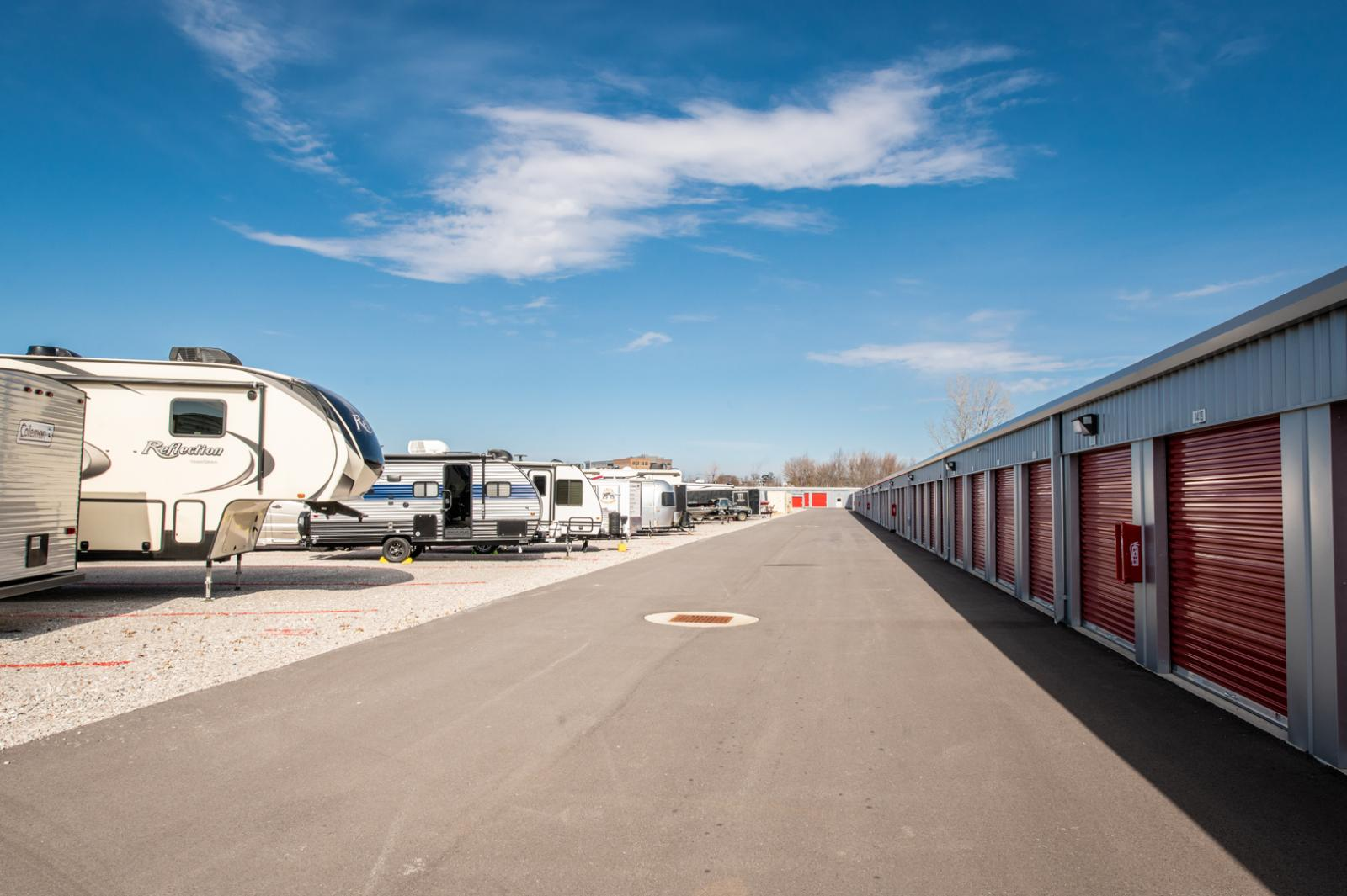 Photo of a line of RVs parked inside the secure facility provided at Modern Storage in Bentonville, Arkansas.