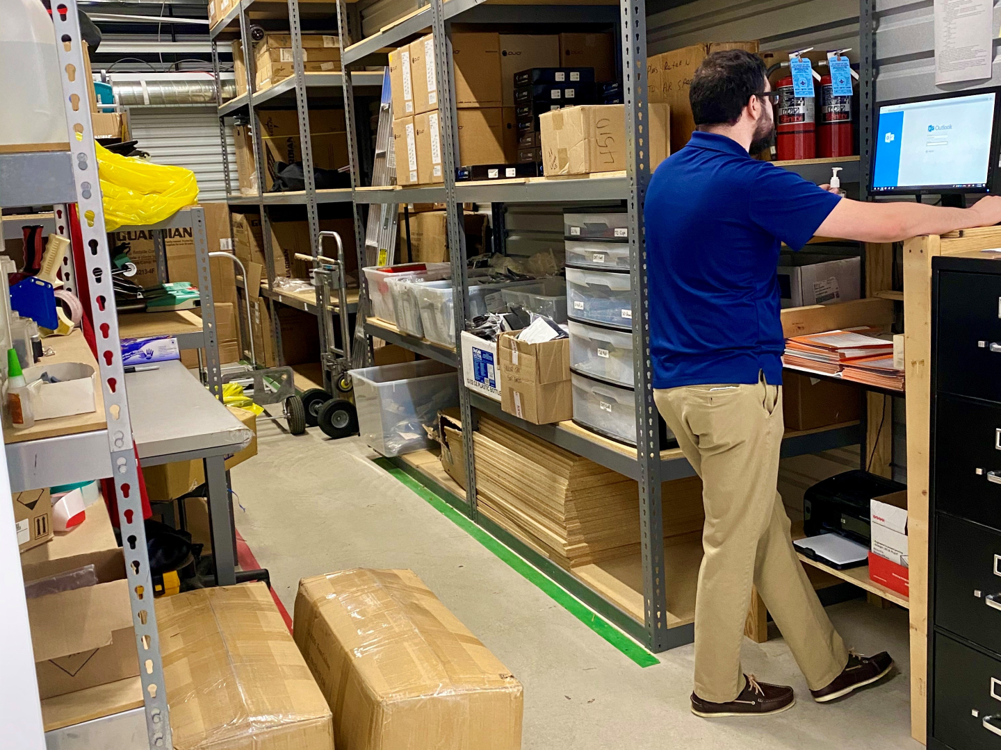 Photo of person inside an organized storage unit. Get organization tips from the Modern Storage experts!
