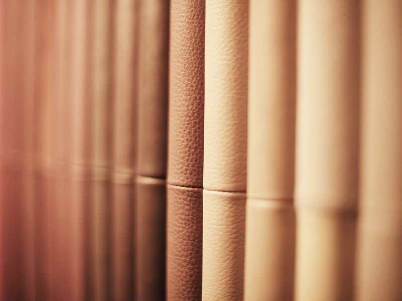 Photo showing a stack of leather fabric samples. Get our tips for storing leather successfully!