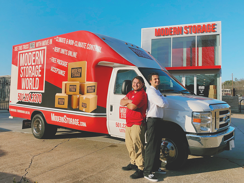 Photo of Modern Storage employees with a moving truck in front of the self-storage facility. Use the Modern Storage referral bonus to get $25 and give $25 to someone you know off their first month.
