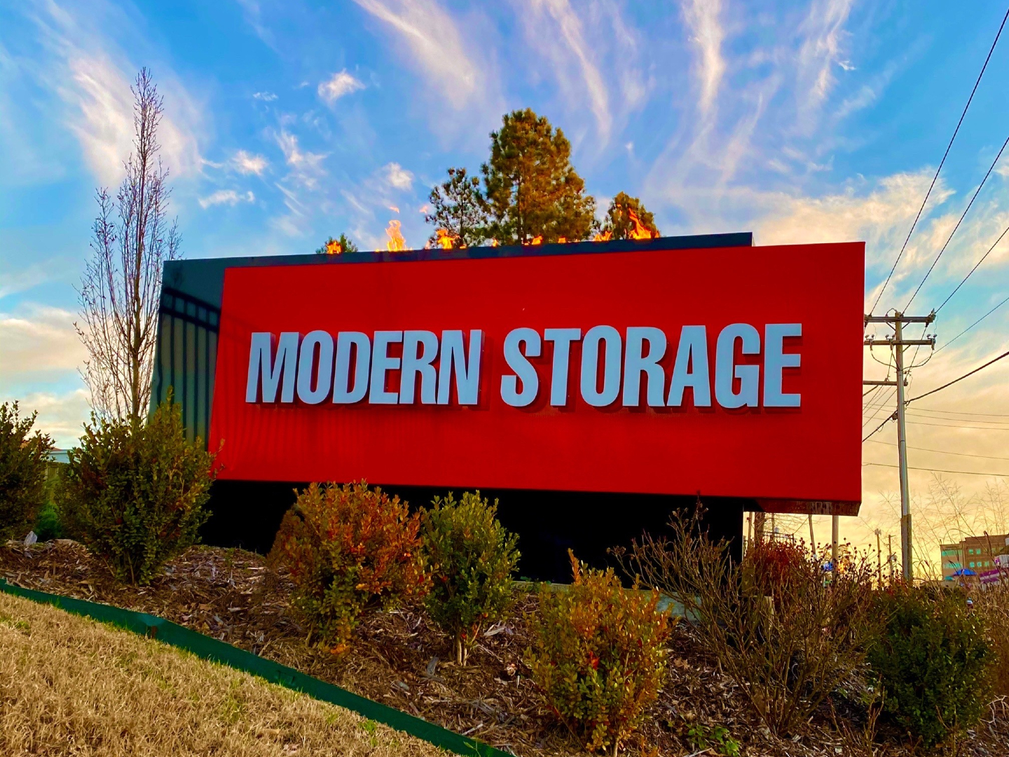 Photo of Modern Storage entrance sign. Find a location near you for a fresh storage start in 2021!