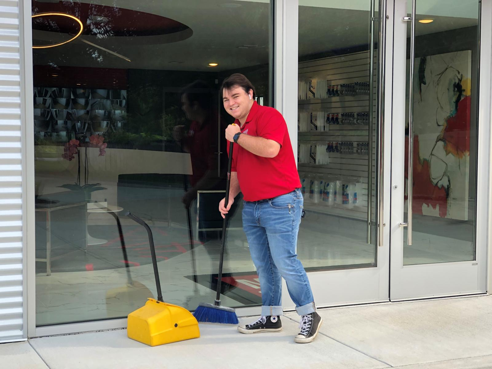 Photo of Modern Storage employee sweeping. We keep our storage facilities clean, but your storage unit is your responsibility. Here are some tips on keeping it clean!