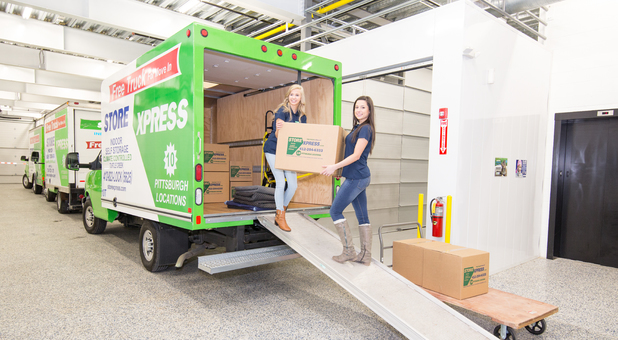 Moving Truck And Customer Service Reps At STORExpress