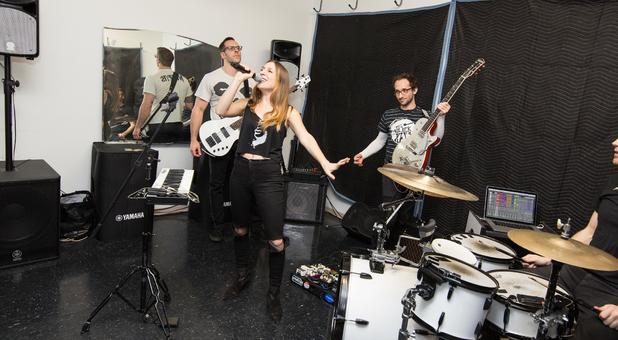 Musicians Practicing In Music Studio At STORExpress Self Storage